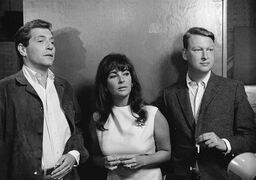 """FILE - Elizabeth Taylor is flanked by actor George Segal, left, a co-star in """"Who's Afraid of Virginia Woolf?"""" and Mike Nichols director of the film, as they watched preparation in this Oct. 20, 1965 file photo taken in Hollywood, ABC News confirms Nichols died Wednesday Nov. 19, 2014. He was 83. (AP Photo/File)"""