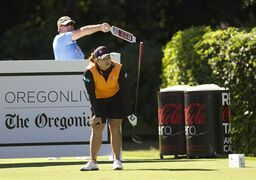 Ariya Jutanugarn, of Thailand, watches a wayward drive on the ninth hole in the first round of the Portland Classic golf Tournament,Thursday, Aug. 28, 2014, in Portlad, Ore. (AP Photo/The Oregonian, Michael Lloyd) MAGAZINES OUT; TV OUT; LOCAL TELEVISION OUT; LOCAL INTERNET OUT; THE MERCURY OUT; WILLAMETTE WEEK OUT; PAMPLIN MEDIA GROUP OUT