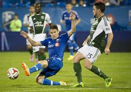 Montreal Impact's Maxim Tissot tries to block the pass of Portland Timbers' Danny O'Rourke during second half MLS action in Montreal on Sunday, July 27, 2014. (AP Photo/The Canadian Press, Peter McCabe)