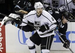San Jose Sharks' Patrick Marleau (12) collides with Los Angeles Kings defenseman Drew Doughty (8) during the third period in Game 4 of their second-round NHL hockey Stanley Cup playoff series in San Jose, Calif., Tuesday, May 21, 2013. San Jose won 2-1.(AP Photo/Marcio Jose Sanchez)