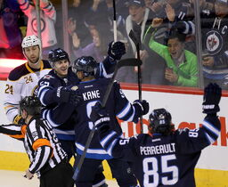 Mark Scheiflele greets Evander Kane with a big grin after Kane scores early in the third period Tuesday.