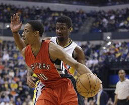 Toronto Raptors' DeMar DeRozan (10) goes to the basket against Indiana Pacers' Solomon Hill (44) during the first half of an NBA basketball game Tuesday, Jan. 27, 2015, in Indianapolis. (AP Photo/Darron Cummings)