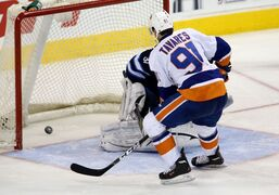 New York Islanders captain John Tavares puts the game-winning shootout goal past Winnipeg Jets goaltender Ondrej Pavelec Saturday.