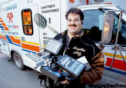 Locksmith Darren Ingleson with the former ambulance he's converted into his 'office on wheels,' and other tools of his unique trade.