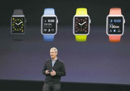 Apple CEO Tim Cook introduces the Apple Watch in March. Demand remains strong for the new product.