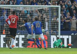 Leicester's Leonardo Ulloa, center, celebrates after scoring a penalty during the English Premier League soccer match between Leicester City and Manchester United at King Power Stadium, in Leicester, England, Sunday, Sept. 21, 2014. (AP Photo/Rui Vieira)