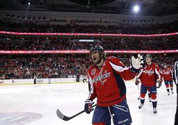 Washington Capitals left wing Alex Ovechkin (8), from Russia, celebrates his first goal in the first period of an NHL hockey game against the Edmonton Oilers in Washington on Jan. 20, 2015. Abraham Lincoln returned to the Washington Capitals locker room, shortly after Alex Ovechkin returned to the top of the NHL's goal-scoring race. THE CANADIAN PRESS/AP, Alex Brandon