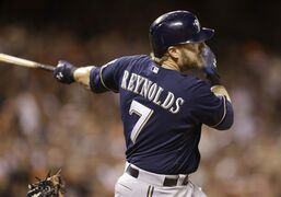 Milwaukee Brewers' Mark Reynolds swings for a single off San Francisco Giants' Jake Peavy in the eighth inning of a baseball game Saturday, Aug. 30, 2014, in San Francisco. (AP Photo/Ben Margot)