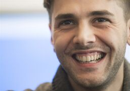Filmmaker Xavier Dolan smiles as he reacts during a press conference in Montreal, Thursday, April 17, 2014, to the news that his latest movie 'Mommy' will be in the official competition at the Cannes Film Festival. THE CANADIAN PRESS/Graham Hughes