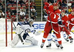 Detroit Red Wings forward Johan Franzen tries to redirect a shot on Winnipeg Jets goalie Ondrej Pavelec during the second period of an NHL game at Joe Louis Arena in Detroit Tuesday. The Jets won 3-2 with captain Andrew Ladd scoring the shootout winner.