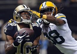 ADVANCE FOR WEEKEND EDITIONS, NOV. 1-2 - FILE - In this Oct. 26, 2014, file photo, New Orleans Saints rookie wide receiver Brandin Cooks (10) pulls in a touchdown reception in front of Green Bay Packers cornerback Tramon Williams (38) in the second half of an NFL football game in New Orleans. Rookies, especially those selected high in the draft, not only are given a chance to prove themselves but are expected to contribute immediately. (AP Photo/Bill Haber, File)