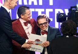 Cleveland Cavaliers owner Dan Gilbert congratulates his son Nick Gilbert after the team won the NBA basketball draft lottery, Tuesday, May 21, 2013 in New York. (AP Photo/Jason DeCrow)