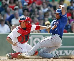 FILE - In this July 18, 2010, file photo, Texas Rangers' Elvis Andrus, right, is safe at home plate as Boston Red Sox's Kevin Cash puts the tag on in the eighth inning of a baseball game in Boston. Raul Ibanez, Cash and Don Wakamatsu are the finalists to replace Joe Maddon as manager of the Tampa Bay Rays announced Friday, Nov. 21, 2014. (AP Photo/Michael Dwyer, File)