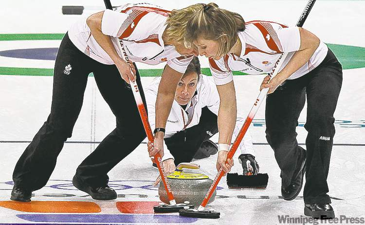 Brushers Carolyn Darbyshire (left) and Cori Bartel (right) used brushes with foil inserts when sweeping for Cheryl Bernard's silver medallists in Vancouver.