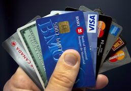 Credit cards are displayed in Montreal on December 12, 2012. A sustained period of low interest rates has allowed Canadians to rack up record levels of debt which, along with tumbling oil prices, pose a threat to the country's financial stability, economists say. THE CANADIAN PRESS/Ryan Remiorz