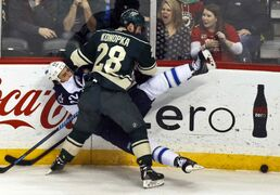 Zenon Konopka of the Minnesota Wild and Chris Thorburn of the Winnipeg Jets mix it up during the first period.
