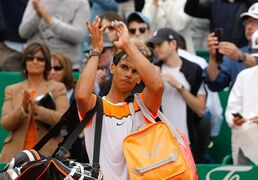 Rafael Nadal of Spain applauds his supporters after losing the semifinal match of the Monte Carlo Tennis Masters tournament against Novak Djokovic of Serbia, in Monaco, Saturday, April 18, 2015. (AP Photo/Claude Paris)