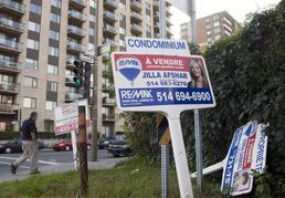 A sale signs stand in front of a condominium Tuesday, September 27, 2011 in Montreal. THE CANADIAN PRESS/Ryan Remiorz