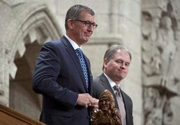 Newfoundland and Labrador Premier Paul Davis and Municipal and Intergovernmental Affairs Minister Keith Hutchings (right) are recognized following Question Period in the House of Commons Friday December 12, 2014 in Ottawa. The year 2014 in Newfoundland and Labrador politics started with electricity blackouts that sealed one premier's demise, and ended with a fiscal meltdown that threatens another. THE CANADIAN PRESS/Adrian Wyld