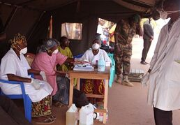 Health care workers at a screening center for the Ebola virus await patients at the border village of Kouremale, Mali, on Nov. 17, 2014. The Ebola apocalypse scenario is off the table. But where exactly is this epidemic going?Unfortunately no one is entirely sure. THE CANADIAN PRESS/AP, Baba Ahmed