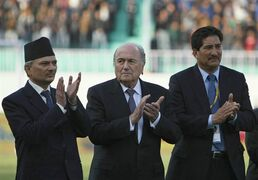 FILE - In this March 8, 2012 file photo, Nepal's Prime Minister Baburam Bhattarai, left, FIFA President Joseph S. Blatter, center, and All Nepal Football Association President Ganesh Thapa, applaud during the AFC Challenge Cup football tournament opening ceremony in Katmandu, Nepal. Nepal's powerful parliamentary committee accused the long-time chief of the national football association Ganesh Thapa of embezzling millions and ordered government agencies to investigate, file a case in court, and suspend him. (AP Photo/Binod Joshi, File)
