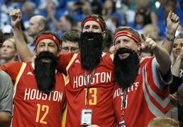 Houston Rockets fans cheer on their team at the start of the first half of Game 4 in an NBA basketball first-round playoff series against the Dallas Mavericks, Sunday, April 26, 2015, in Dallas. (AP Photo/Tony Gutierrez)
