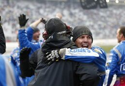 Members of Jimmie Johnson's pit crew react after winning the NASCAR Sprint Cup series auto race at Atlanta Motor Speedway, Sunday, March 1, 2015, in Hampton, Ga. (AP Photo/John Bazemore)