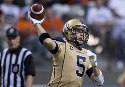 Winnipeg Blue Bombers quarterback Drew Willy throws the ball during the first half of CFL football action against the B.C. Lions in Vancouver, B.C., on Saturday Sept. 13, 2014. THE CANADIAN PRESS/Jonathan Hayward