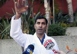 Dr. Sanjay Khurana talks to reporters, at his office in Marina Del Rey, Calif., on Friday, March 6, 2015, about how he saw actor Harrison Ford's plane falling from the sky while on a golf course on Thursday. Khurana was one of the first people to come to Ford's aid after the crash. (AP Photo/Nick Ut)
