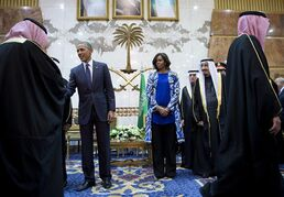 President Barack Obama and first lady Michelle Obama participate in a delegation receiving line with the new Saudi Arabian King, Salman bin Abdul Aziz, in Riyadh, Saudi Arabia, Tuesday, Jan. 27, 2015. The president and first lady have come to express their condolences on the death of the late Saudi Arabian King Abdullah bin Abdulaziz al-Saud.