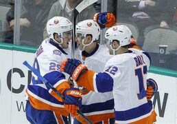 New York Islanders left wing Josh Bailey (12) is congratulated by teammates Brock Nelson (29) and Ryan Strome after his goal against Dallas Stars in the first period of an NHL hockey game Tuesday, March 3, 2015, in Dallas. (AP Photo/Tim Sharp)