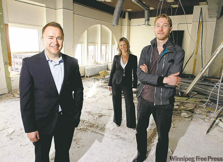 Husband-and-wife team, CEO Mark Buleziuk (left) and vice­president Shelley Buleziuk, with architect Matt Kessler at 272 Main St.