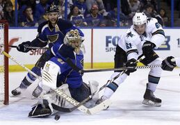 St. Louis Blues goalie Jaroslav Halak makes a save on a shot by San Jose Sharks' Justin Braun (61) as Blues' Alex Pietrangelo (27) watches during the third period of an NHL hockey game Tuesday, Dec. 17, 2013, in St. Louis. The Sharks have signed Braun to a $19 million, five-year extension. THE CANADIAN PRESS/AP/Jeff Roberson