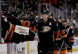 Anaheim Ducks right wing Corey Perry celebrates his goal against the Buffalo Sabres during the first period of an NHL hockey game in Anaheim, Calif., Wednesday, Oct. 22, 2014. (AP Photo/Chris Carlson)