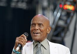 FILE - In this July 20, 2014 file photo, singer and activist Harry Belafonte speaks during a memorial tribute concert for folk icon and civil rights activist Pete Seeger at Lincoln Center's Damrosch Park in New York. Belafonte and Maureen O'Hara are among those will be honored by the motion picture academy's board of governors. The academy said Thursday, Aug. 28, 2014, that Belafonte will receive the Jean Hersholt Humanitarian Award at the academy's sixth annual Governors Awards on Nov. 8 in Los Angeles. (AP Photo/Kathy Willens, file)