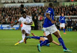 Swansea City's Wilfried Bony, left, scores his side's first goal during their English Premier League soccer match against Leicester City at The Liberty Stadium, Swansea, Wales, Saturday, Oct. 25, 2014. (AP Photo/Nick Potts, PA Wire) UNITED KINGDOM OUT - NO SALES - NO ARCHIVES