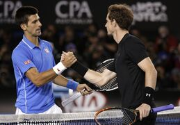 Novak Djokovic of Serbia, left, is congratulated by Andy Murray of Britain after winning the men's singles final at the Australian Open tennis championship in Melbourne, Australia, Sunday, Feb. 1, 2015. (AP Photo/Vincent Thian)