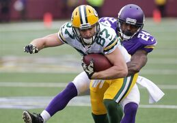 Green Bay Packers wide receiver Jordy Nelson (87) is tackled by Minnesota Vikings cornerback Captain Munnerlyn (24) after making a reception during the second half of an NFL football game, Sunday, Nov. 23, 2014, in Minneapolis. (AP Photo/Jim Mone)