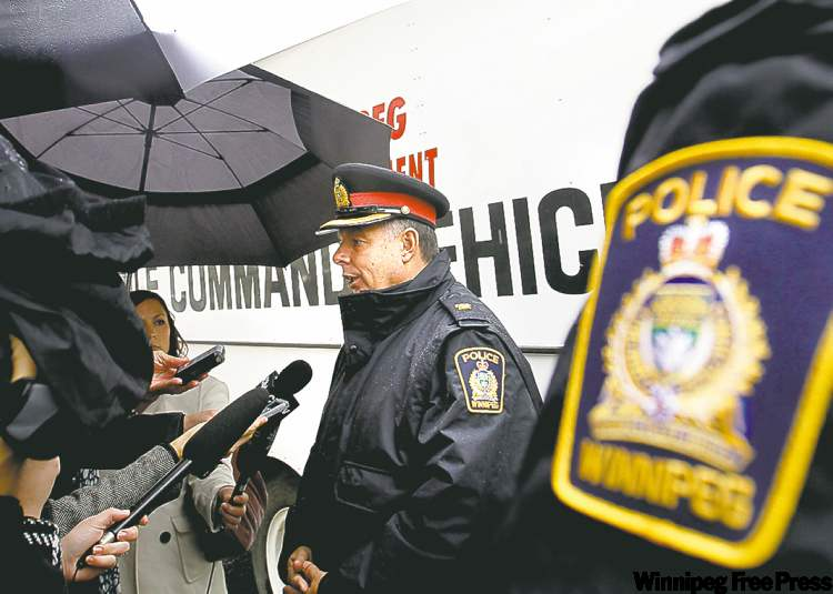 Insp. Brian Cyncora speaks outside the police mobile command unit on Selkirk Avenue.
