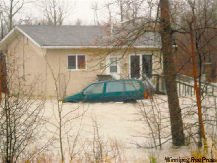 Water at Sagkeeng rises on a home and vehicle.