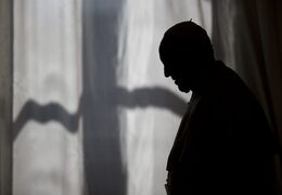 Pope Francis is silhouetted as he leaves after his meeting with Prime Minister of Albania Edi Rama and his wife Linda, at the Vatican, Thursday, April 24, 2014. (AP Photo/Alessandra Tarantino, Pool)
