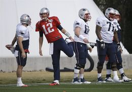 New England Patriots quarterback Tom Brady (12) stretches with teammates during practice Wednesday, Jan. 28, 2015, in Tempe, Ariz. The Patriots play the Seattle Seahawks in NFL football Super Bowl XLIX Sunday, Feb. 1, in Glendale, Ariz. (AP Photo/Mark Humphrey)