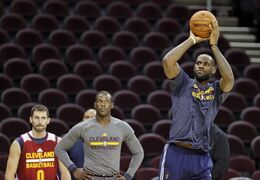 Cleveland Cavaliers' LeBron James, right, shoots during practice as Kevin Love (0) and Dion Waiters watch Wednesday, Oct. 29, 2014, in Cleveland. It will be a night unlike any in Cleveland sports history as LeBron James returns to play his first NBA regular-season game for the Cavaliers in four years. Any bitterness toward James has been replaced with forgiveness by a city thirsting for a championship. (AP Photo/Mark Duncan)