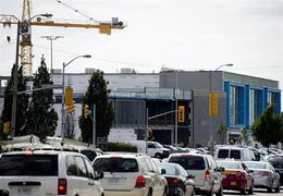 A construction crane towers over the expanding Sherway Gardens mall in Toronto on Friday, July 25, 2014. THE CANADIAN PRESS/Nathan Denette