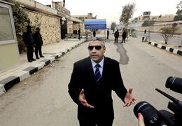 Canadian Al-Jazeera English journalist Mohamed Fahmy, speaks to the media outside a court before his retrial in Cairo, Egypt, on Feb. 23, 2015. The high-profile human rights lawyer for a Canadian journalist on trial in Egypt is lashing out at what she calls Canada's