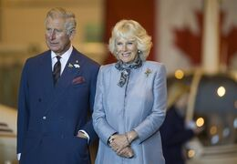 Prince Charles and wife Camilla look on in Winnipeg on Wednesday, May 21, 2014. THE CANADIAN PRESS/David Lipnowski