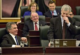 Alberta Premier Jim Prentice, left, and Alberta Finance Minister Robin Campbell have a laugh as Campbell delivers the 2015 budget in Edmonton, Alta., on Thursday, March 26, 2015. THE CANADIAN PRESS/Jason Franson