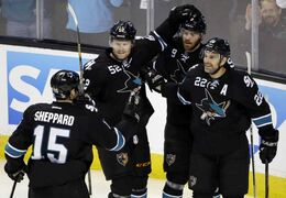 San Jose Sharks' Dan Boyle (22), celebrates his goal against the Winnipeg Jets with teammates Martin Havlat (9), Matt Irwin (52) and James Sheppard (15) during the first period on Thursday, March 27 in San Jose, Calif.
