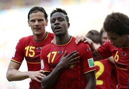 "FILE - In this Sunday, June 22, 2014 file photo, Belgium's Divock Origi, center, celebrates with teammates Daniel Van Buyten, left, and Belgium's Axel Witsel, right, after Origi scored the opening goal during the group H World Cup soccer match between Belgium and Russia at the Maracana stadium in Rio de Janeiro, Brazil. Liverpool says it has signed Belgium striker Divock Origi from Lille and will loan him back to the French club for the whole of next season. The 19-year-old forward, who impressed during Belgium's run to the quarterfinals of the World Cup, completed his transfer in the United States - where Liverpool is on a pre-season tour. The club said he had signed a ""long-term deal"" without giving details. British media put the transfer fee at 10 million pounds ($17 million). Origi, who joined Lille from Genk in 2010, says ""Liverpool is one of the greatest clubs in the world and I'm very excited to be part of this great history."" (AP Photo/Ivan Sekretarev, file)"