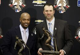 Retired Chicago White Sox first baseman Paul Konerko and Philadelphia Phillies shortstop Jimmy Rollins pose with their trophies after being named co-winners of the 2014 Roberto Clemente Award before Game 3 of baseball's World Series between the Kansas City Royals and the San Francisco Giants Friday, Oct. 24, 2014, in San Francisco. (AP Photo/Eric Risberg)